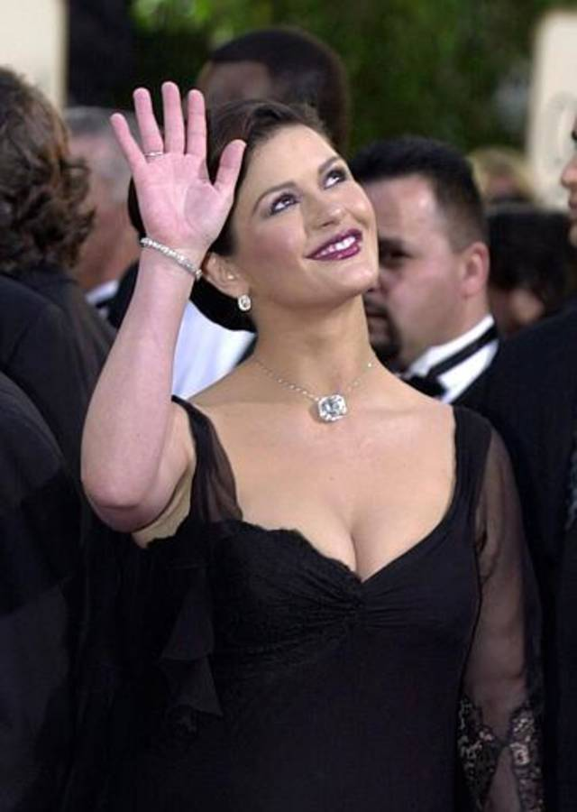 "Welsh actress Catherine Zeta-Jones, nominated for best performance by an actress in a motion picture-musical or comedy for her work in ""Chicago,"" arrives for the 60th Annual Golden Globe Awards, in Beverly Hills, Calif., Sunday, Jan. 19, 2003. (AP Photo/Mark J. Terrill)"