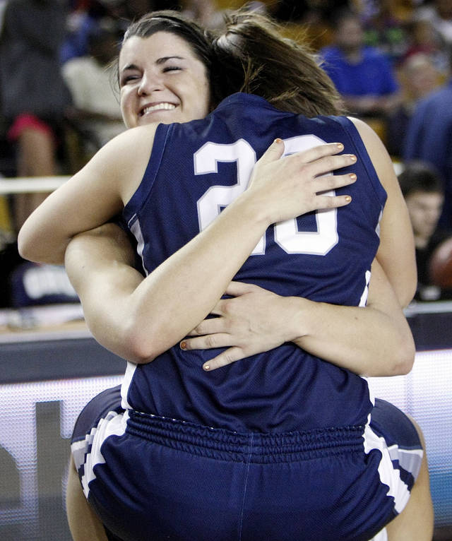 Shawnee's Taylor Cooper (10) and McKenzie Cooper (20) hug after the Class 5A girls high school basketball state tournament championship game between Shawnee and East Central at the Mabee Center in Tulsa, Okla., Saturday, March 10, 2012. Shawnee won, 45-41. Photo by Nate Billings, The Oklahoman