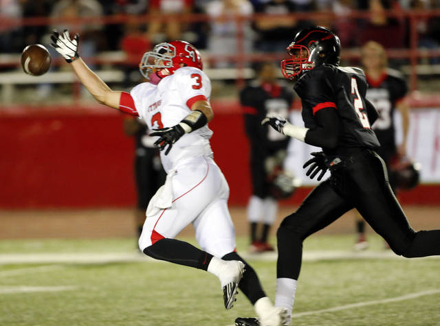 Carl Albert's Steven Thompson barely misses an interception of a ball intended for Del City's Ahnte Harkey as the Titans play the Eagles in Class 5A, first round, playoff action in high school football on Friday, Nov. 9, 2012 in Del City, Okla.   Photo by Steve Sisney, The Oklahoman