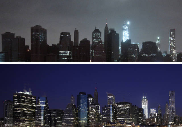 This combination of photos shows above, lower Manhattan dark after the hybrid storm Sandy on Monday, Oct. 29, 2012, and below a fully lit skyline on Jan. 6, 2012, both seen from the Brooklyn borough of New York. In an attempt to lessen damage from saltwater to the subway system and the electrical network beneath the city's financial district, New York City's main utility cut power to about 6,500 customers in lower Manhattan. But a far wider swath of the city was hit with blackouts caused by flooding and transformer explosions. (AP Photo) ORG XMIT: NY116