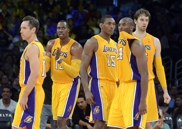 Members of the Los Angeles Lakers, from left, Steve Nash, Dwight Howard, Metta World Peace, Kobe Bryant and Pau Gasol, of Spain, look on during the second half of their preseason NBA basketball game against the Sacramento Kings, Sunday, Oct. 21, 2012, in Los Angeles. The Kings won 99-92. (AP Photo/Mark J. Terrill)