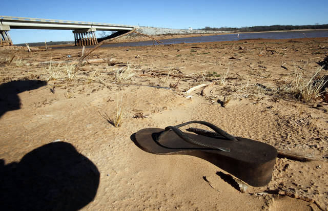 An abandoned shoe sets well above the water line at Lake Thunderbird. PHOTO BY STEVE SISNEY, THE OKLAHOMAN <strong>STEVE SISNEY</strong>