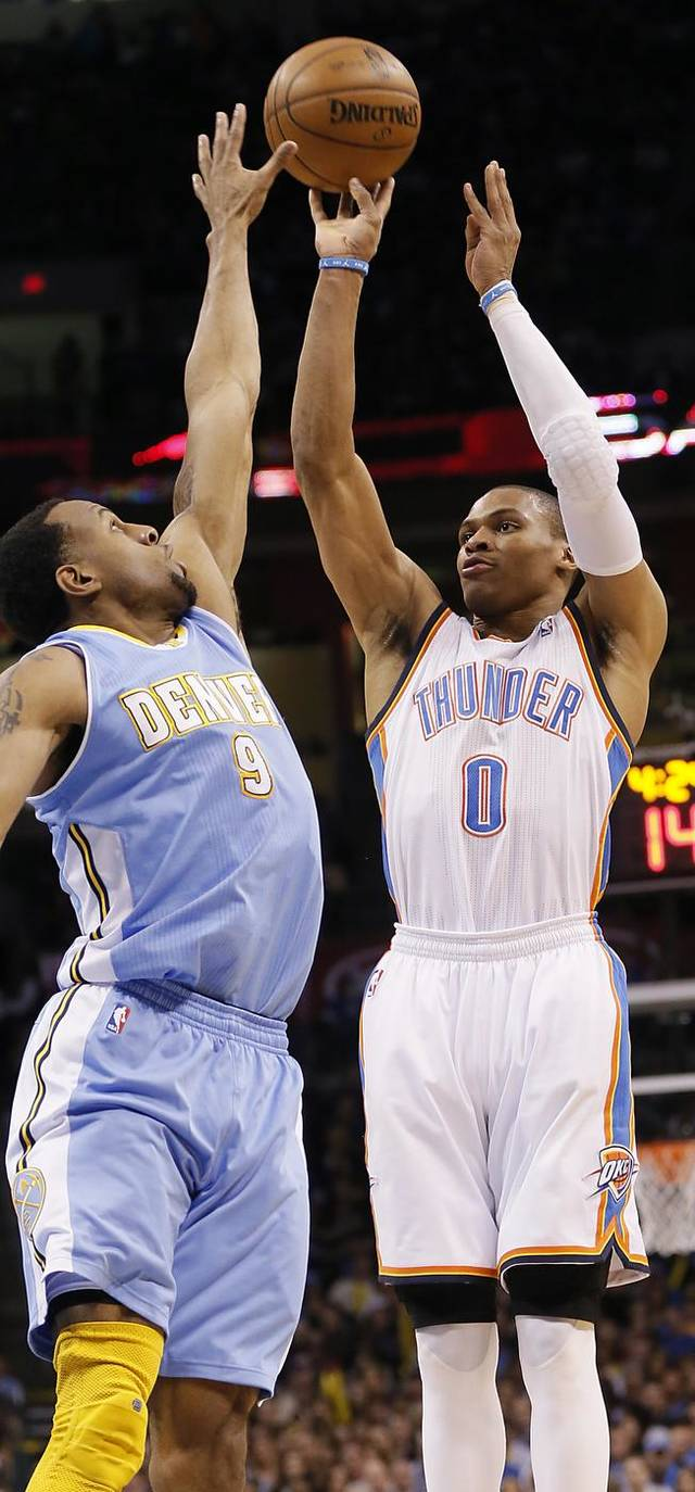 Oklahoma City&#039;s Russell Westbrook (0) shoots over Denver&#039;s Andre Iguodala (9) during the NBA basketball game between the Oklahoma City Thunder and the Denver Nuggets at the Chesapeake Energy Arena on Wednesday, Jan. 16, 2013, in Oklahoma City, Okla.  Photo by Chris Landsberger, The Oklahoman