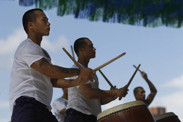 In this image made on June 14, 2011, young convicts practice Chinese style drum beats in the Changhua prison, in Changhua central Taiwan. Taiwan's U-Theatre Ensemble of drummers and Chinese operatic dancers leverage the spirituality of Zen Buddhism and Tai Chi Chuan exercises to try to instill a new sense of equanimity among the young convicts, most of whom have violence tinged-records mixed with serious drug abuse. (AP Photo/Wally Santana)
