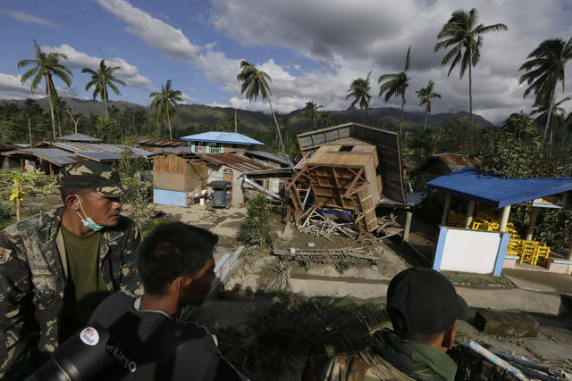 Filipino soldiers search for victims and survivors amid the devastation left by Typhoon Bopha, in the village of Andap, New Bataan township, Compostela Valley in southern Philippines Wednesday, Dec. 5, 2012. Typhoon Bopha, one of the strongest typhoons to hit the Philippines this year, barreled across the country's south on Tuesday, killing scores of people while triggering landslides, flooding and cutting off power in two entire provinces. (AP Photo/Bullit Marquez)