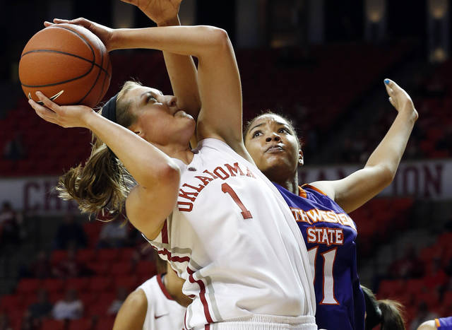 Oklahoma Sooners' Nicole Kornet (1) shoots guarded by Northwestern State Lady Demons' Breanna Fuller (11) as the University of Oklahoma (OU) Sooner women's basketball team plays the Northwestern State Lady Demons at the Lloyd Noble Center on Thursday, Nov. 29, 2012  in Norman, Okla. Photo by Steve Sisney, The Oklahoman