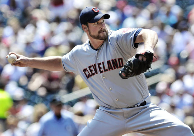 Cleveland Indians pitcher Derek Lowe throws against the Minnesota Twins in the first inning of a baseball game, Tuesday, May 15, 2012, in Minneapolis. (AP Photo/Jim Mone)