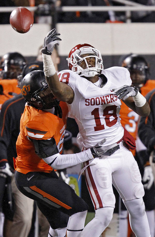 Oklahoma State's Daytawion Lowe (8) breaks up a pass for Oklahoma's Kameel Jackson (18) during the Bedlam college football game between the Oklahoma State University Cowboys (OSU) and the University of Oklahoma Sooners (OU) at Boone Pickens Stadium in Stillwater, Okla., Saturday, Dec. 3, 2011. Photo by Chris Landsberger, The Oklahoman