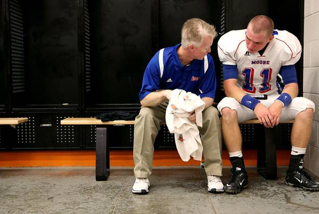 MOORE HIGH SCHOOL FOOTBALL: Moore head football coach Scott Myers talks with quarterback Vova Razryvin before a game at Norman High School in Norman on Friday, Sept. 10, 2010. Photo by John Clanton, The Oklahoman ORG XMIT: KOD