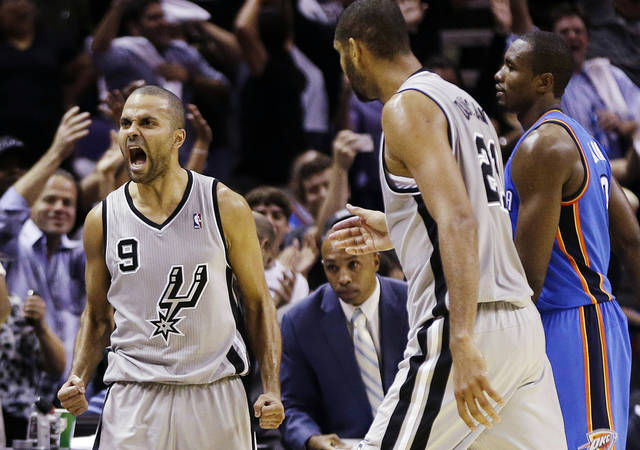 San Antonio Spurs' Tony Parker (9), of France, reacts after hitting a buzzer-beating basket to end the fourth quarter of an NBA basketball game against the Oklahoma City Thunder, Thursday, Nov. 1, 2012, in San Antonio. San Antonio won 86-84. Spurs' Tim Duncan, center, walks to Parker as Oklahoma City's Serge Ibaka, right, walks off the court. (AP Photo/Eric Gay) ORG XMIT: TXEG114