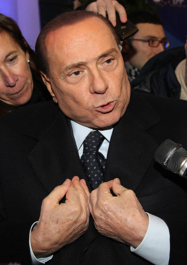 Italy's EPP party member Silvio Berlusconi talks to the media at the end of the European People's Party summit, ahead of the EU summit in Brussels on Thursday, Dec. 13, 2012. In one whirlwind morning, the European Union nations agreed on the foundation of a fully-fledged banking union and Greece�s euro partners approved billions of euros in bailout loans that will prevent the nation from going bankrupt. (AP Photo/Yves Logghe)