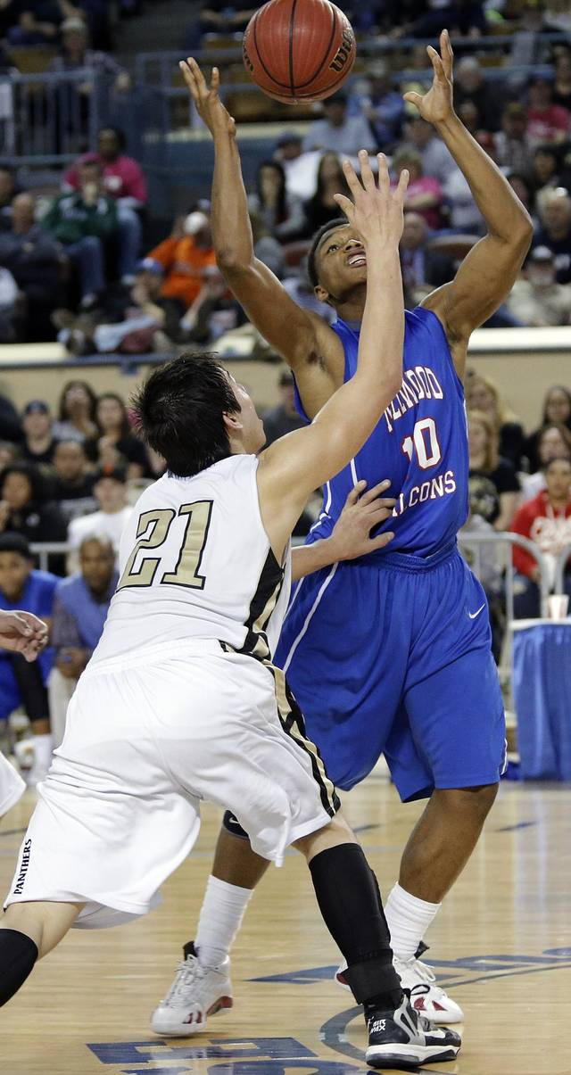 Okemah's Dion Scott (21) and Millwood's Chris Crook (10) go after a loose ball during the state high school basketball tournament Class 3A boys championship game between Millwood High School and Okemah High School at the State Fair Arena on Saturday, March 9, 2013, in Oklahoma City, Okla. Photo by Chris Landsberger, The Oklahoman