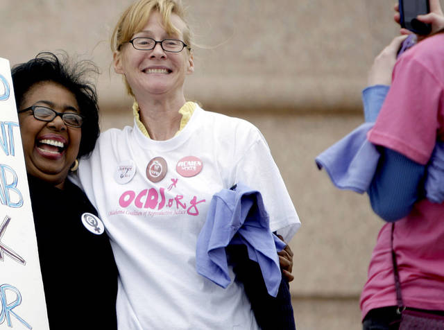 Sen. Judy Eason McIntyre poses with a protester during a rally opposing the Personhood measures at the state Capitol, Tuesday, Feb. 28, 2012. Photo by Sarah Phipps, The Oklahoman