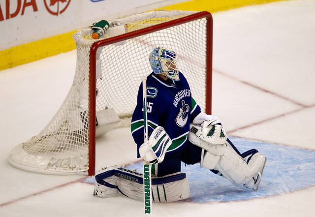 Vancouver Canucks' goalie Cory Schneider looks on after Los Angeles Kings' Jarret Stoll, not pictured, scored the game-winning goal during the first overtime period of game 5 of an NHL Western Conference quarterfinal Stanley Cup playoff hockey series in Vancouver, British Columbia on Sunday April 22, 2012. Los Angeles won the series 4 games to 1. (AP Photo/The Canadian Press, Darryl Dyck)