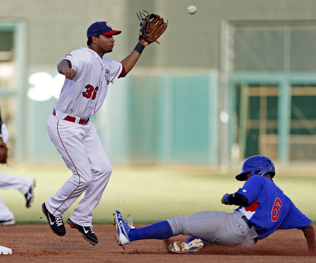 The RedHawks� Angel Sanchez, left, leaps for the ball as Iowa�s Dave Sappelt steals second base during first-inning action at Chickasaw Bricktown Ballpark on Wednesday.  Photo by Bryan Terry, The Oklahoman