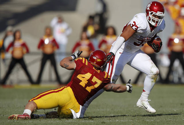 Oklahoma's Trey Millard (33) runs past Iowa State's A.J. Klein (47) during a college football game between the University of Oklahoma (OU) and Iowa State University (ISU) at Jack Trice Stadium in Ames, Iowa, Saturday, Nov. 3, 2012. Oklahoma won 35-20. Photo by Bryan Terry, The Oklahoman