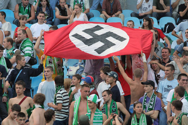 In this photo taken Aug. 19, 2007 soccer fans show German Nazi flag with a swastika during an Ukrainian League Championship soccer match between Dynamo Kyiv and Karpaty in Kiev, Ukraine. Kiev and Warsaw on Tuesday May 29, 2012 decried a BBC report that portrayed Ukrainian and Polish soccer fans as racist ahead of next month's European championship as unfair, vowing that all foreign guests would be safe to attend matches in the two Eastern European countries. (AP Photo/Ukrinform)