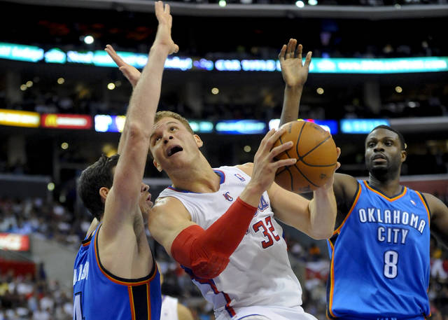 L.A. CLIPPERS: Oklahoma City Thunder forward Nick Collison, left, and center Nazr Mohammed (8) double team Los Angeles Clippers forward Blake Griffin (32)  in the first half of an NBA basketball game, Monday, April 16, 2012, in Los Angeles. (AP Photo/Gus Ruelas) ORG XMIT: LAS101