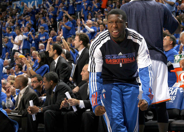 Oklahoma City&#039;s Nate Robinson (3) celebrates on the bench during the first round NBA basketball playoff game between the Oklahoma City Thunder and the Denver Nuggets on Wednesday, April 20, 2011, at the Oklahoma City Arena. Photo by Sarah Phipps, The Oklahoman