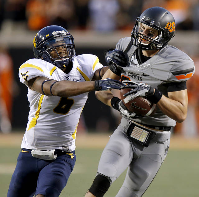 Oklahoma State's Austin Hays (84) catches a pass beside West Virginia's Pat Miller (6) during a college football game between Oklahoma State University (OSU) and West Virginia University at Boone Pickens Stadium in Stillwater, Okla., Saturday, Nov. 10, 2012. Oklahoma State won 55-34. Photo by Bryan Terry, The Oklahoman