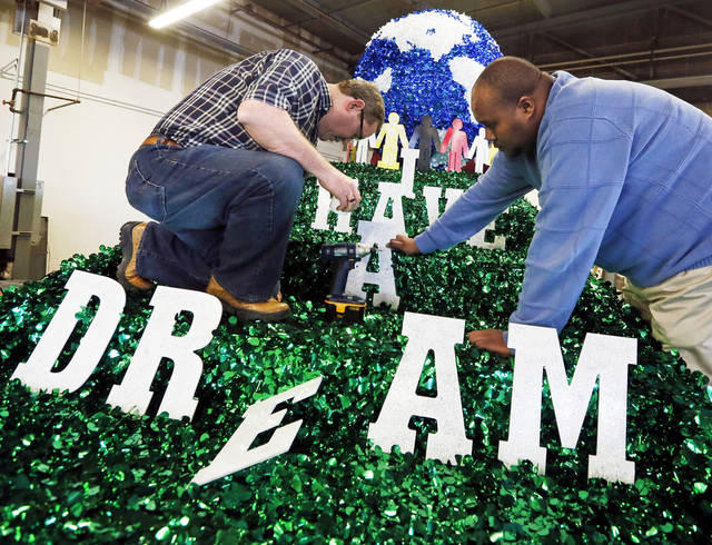 "Henry Bluejacket, left, and Jelani Toure attach letters to spell ""I Have A Dream"" on the ONG float for the Martin Luther King Jr. Day Parade, at Oklahoma Natural Gas, 4901 N Santa Fe, in Oklahoma City, Wednesday, Jan. 16, 2013. ONG will have approximately 60 employees and their family members  walking with the float along with a drill team of 20 employees and family members during the parade, according to Tommy Brown with ONG (not pictured). Photo by Nate Billings, The Oklahoman"