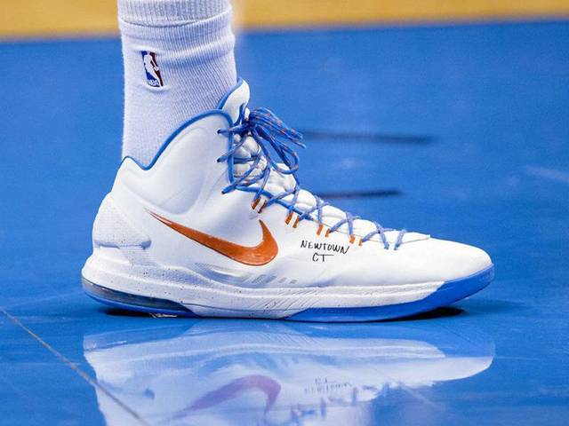 "Thunder star Kevin Durant honored the victims in Newtown, Conn., on Friday by writing ""NEWTOWN CT"" on his shoes in the Thunder's 113-103 win against the Kings. Photo provided by Richard Rowe, Oklahoma City Thunder <strong></strong>"