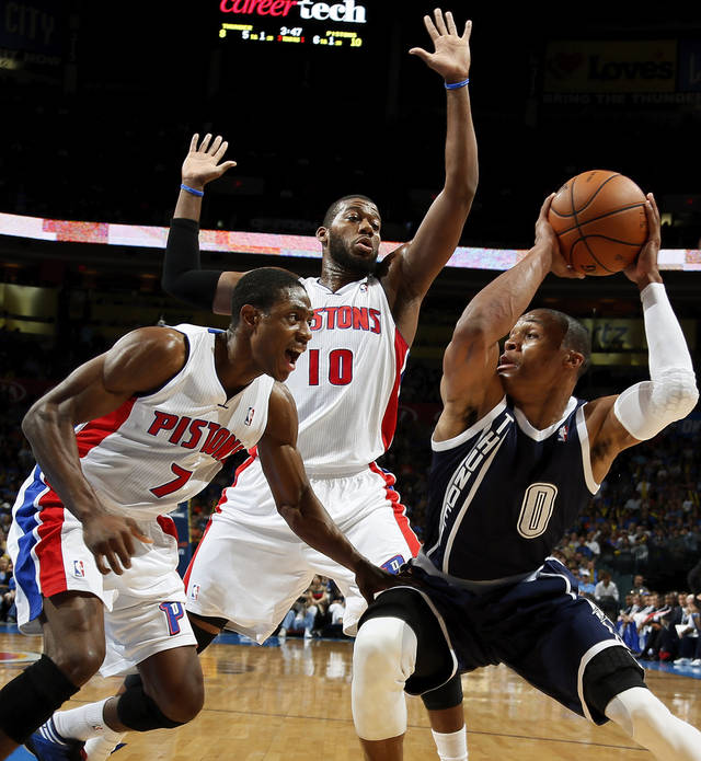 Oklahoma City&#039;s Russell Westbrook (0) works against Detroit&#039;s Greg Monroe (10) and Brandon Knight (7) during an NBA basketball game between the Detroit Pistons and the Oklahoma City Thunder at the Chesapeake Energy Arena in Oklahoma City, Friday, Nov. 9, 2012. Photo by Nate Billings, The Oklahoman