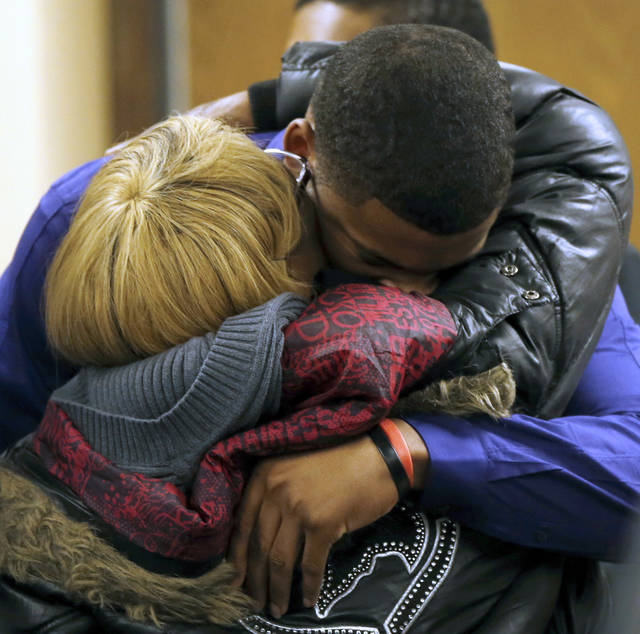 Ma'lik Richmond, top, hugs his mother Daphne Birden, after closing arguments were made on the fourth day of the juvenile trial for Ma'lik and co-defendant Trent Mays on rape charges on Saturday, March 16, 2013 in Steubenville, Ohio. The pair are accused of raping a 16-year-old West Virginia girl in August 2012.  (AP Photo/Keith Srakocic, Pool)