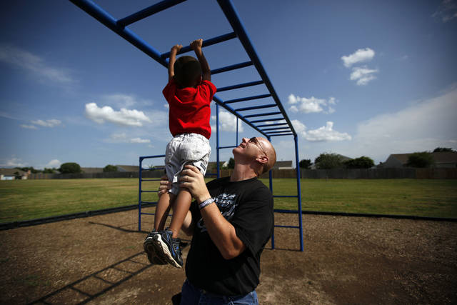 James Rushing plays with his foster son, Aiden, 4, at a park at Plaza Towers Grade School in Moore, Okla., Saturday, June 16, 2012. Photo by Sarah Phipps, The Oklahoman Sarah Phipps, The Oklahoman