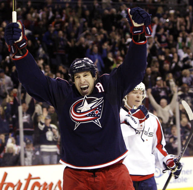 Columbus Blue Jackets' R.J. Umberger (18) celebrates their goal against the Washington Capitals during the second period of an NHL hockey game, Saturday, Dec. 31, 2011, in Columbus, Ohio. (AP Photo/Jay LaPrete)