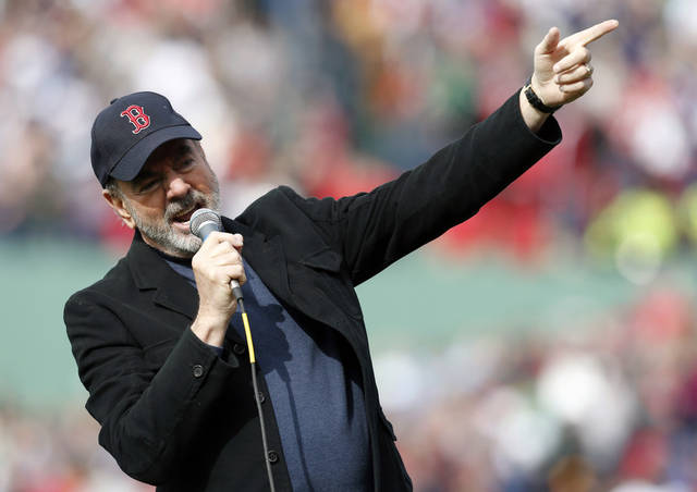 "Neil Diamond sings '""Sweet Caroline"" during the eighth inning of a baseball game between the Boston Red Sox and the Kansas City Royals in Boston, Saturday, April 20, 2013. (AP Photo/Michael Dwyer)"