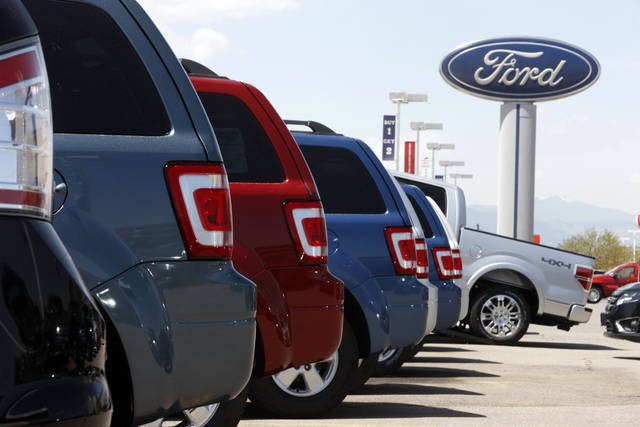 Ford Escapes sit at a Ford dealership in east Denver. AP Photo