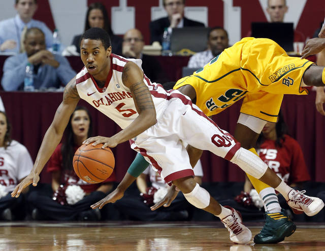 Oklahoma Sooners' Je'lon Hornbeak (5) is folded by Baylor Bears' Taurean Prince (35) going for loose ball as the University of Oklahoma Sooners (OU) men play the Baylor University Bears (BU) in NCAA, college basketball at The Lloyd Noble Center on Saturday, Feb. 23, 2013  in Norman, Okla. Photo by Steve Sisney, The Oklahoman