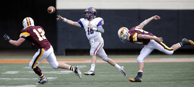 Anadarko's Brandon Pollard (18) throw on the run past Clinton's Ryan Richert (12) and Michael Knabe (59) during the Class 4A Oklahoma state championship football game between Anadarko and Clinton at Boone Pickens Stadium on Saturday, Dec. 1, 2012, in Stillwater, Okla.   Photo by Chris Landsberger, The Oklahoman