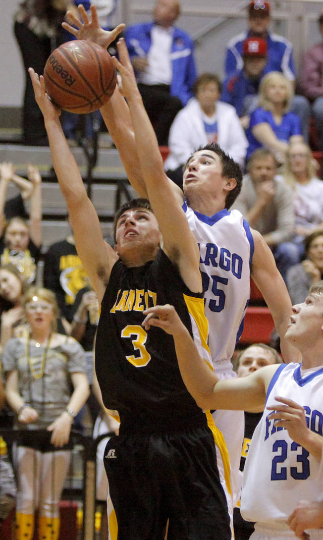 Arnett&#039;s Trevor Bryant, left, goes for a rebound in front of Fargo&#039;s Tyler Howard in first round of the Class B state basketball tournament at Carl Albert in Midwest City, Thursday, March 1, 2012. Photo by Bryan Terry, The Oklahoman