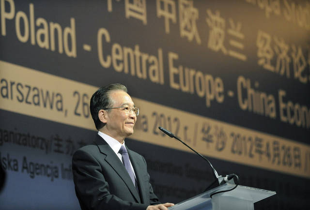China's Prime Minister Wen Jiabao speaks at the opening of the Poland - Central Europe - China Economic Forum in Warsaw, Poland, Thursday, April 26, 2012. Wen Jiabao is Poland on a two day official visit. (AP Photo/Alik Keplicz)