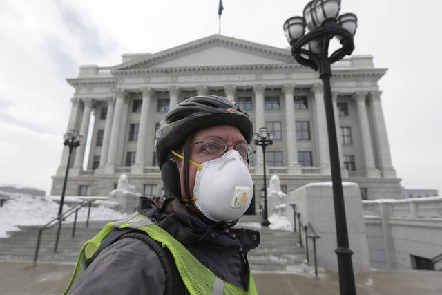 Dr. Gary Kunkel arrives at the Utah State Capitol wearing a breathing mask before a news conference Wednesday, Jan. 23, 2013, in Salt Lake City. A group of doctors is declaring a health emergency over northern Utah's lingering pollution problem.  The U.S. Environmental Protection Agency has singled out the greater Salt Lake region as having the nation's worst air for much of January, when an icy fog smothers mountain valleys for days or weeks at a time and traps lung-busting soot.  (AP Photo/Rick Bowmer)