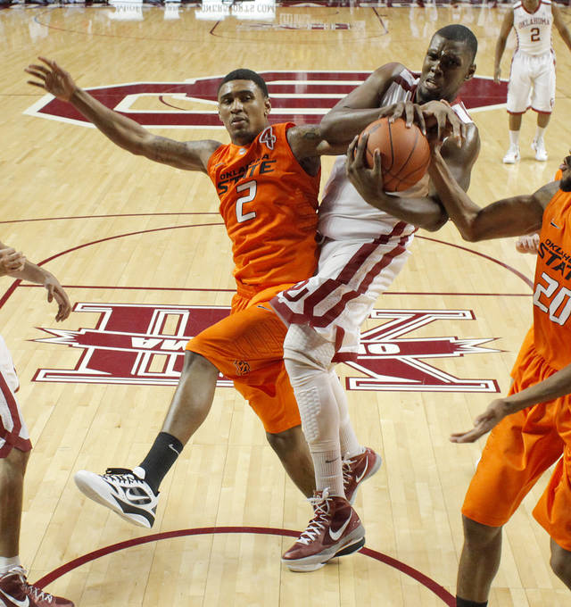 Oklahoma State's Le'Bryan Nash (2) and Oklahoma's Andrew Fitzgerald (4) fight for a rebound during the Bedlam men's college basketball game between the University of Oklahoma Sooners and the Oklahoma State Cowboys in Norman, Okla., Wednesday, Feb. 22, 2012. Oklahoma won 77-64. Photo by Bryan Terry, The Oklahoman