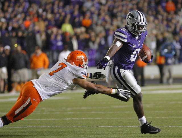 Kansas State's Angelo Pease (8) runs past Oklahoma State's Shamiel Gary (7) during the college football game between the Oklahoma State University Cowboys (OSU) and the Kansas State University Wildcats (KSU) at Bill Snyder Family Football Stadium on Saturday, Nov. 1, 2012, in Manhattan, Kan. Photo by Chris Landsberger, The Oklahoman