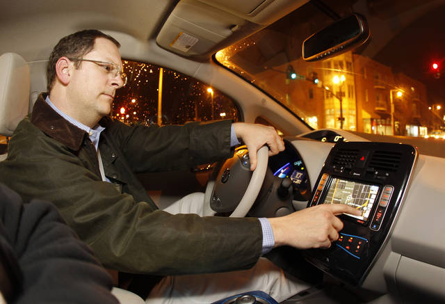 The National Highway Traffic Safety Administration is concerned devices, such as a GPS, can create distractions for drivers. On Thursday, the agency proposed guidelines for manufacturers suggesting that they design dashboards so that distracting devices are automatically disabled unless the vehicle is stopped and the transmission is in park. AP FILE PHOTO