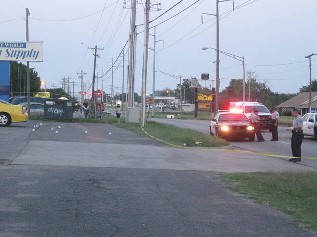 Oklahoma City police officers investigate a shooting Saturday evening in the parking lot of Beauty World Beauty Supply, 5029 NW 10.  PHOTO BY MATT DINGER, THE OKLAHOMAN