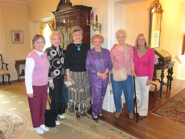 Volunteer Jimmie Cook, fourth from left, who conducts tours at the Governor?s Mansion, treats her Touchmark at Coffee Creek friends to a tour. Also pictured, fom left, are Liz Codding, Rita McLanahan, Joan Crooks, Verna Holtzen and Bev Crowe, Jimmie?s daughter. PHOTO PROVIDED   <strong></strong>