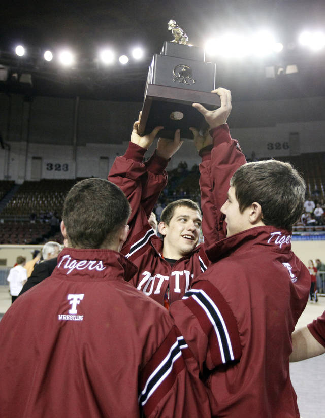 Tuttle celebrates their championship at the state wrestling championships at the State Fair Arena in Oklahoma City, Saturday, Feb. 25, 2012. Photo by Sarah Phipps, The Oklahoman
