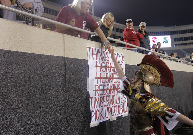 Jenks&#039; mascot Steven Blunk gives high five&#039;s to fans during the Class 6A Oklahoma state championship football game between Norman North High School and Jenks High School at Boone Pickens Stadium on Friday, Nov. 30, 2012, in Stillwater, Okla.   Photo by Chris Landsberger, The Oklahoman