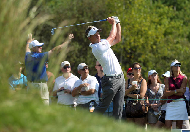 Luke Donald, from England, hits his tee shot on the third tee during the first round of the Deutsche Bank Championship golf tournament at TPC Boston in Norton, Mass., Friday, Aug. 31, 2012. (AP Photo/Stew Milne)