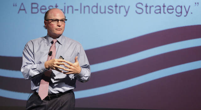 SandRidge CEO Tom Ward talks with employees about the company�s shift to oil from natural gas production in September in Oklahoma City. Photo by Steve Gooch, The Oklahoman Archives