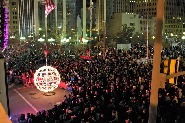 A crowd waits for the giant lighted ball to ascend to mark the start of a new year at a past Opening Night New Year's Eve celebration in downtown Oklahoma City. An estimated 70,000 people attended the grand finale of last year's Opening Night. Photo provided. <strong></strong>