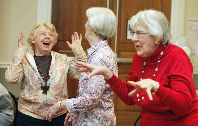 Left: Betty Windsor, Rosemary Mills and Ruthanne Love share some animated laughs Feb. 17 as the Edmond Senior Center holds a laughing yoga class.  Photo By Paul Hellstern, The Oklahoman archives