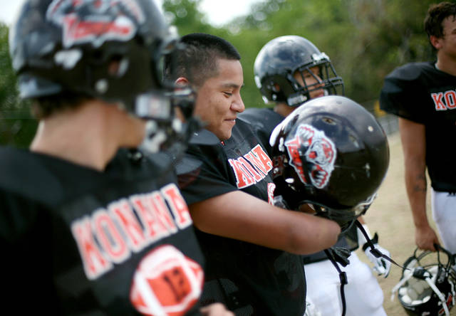 KONAWA HIGH SCHOOL FOOTBALL: Stephen Cully talks with his teammates during a break at practice outside Konawa High School in Konawa, Okla., on Monday, Aug. 29, 2011. Photo by John Clanton, The Oklahoman ORG XMIT: KOD