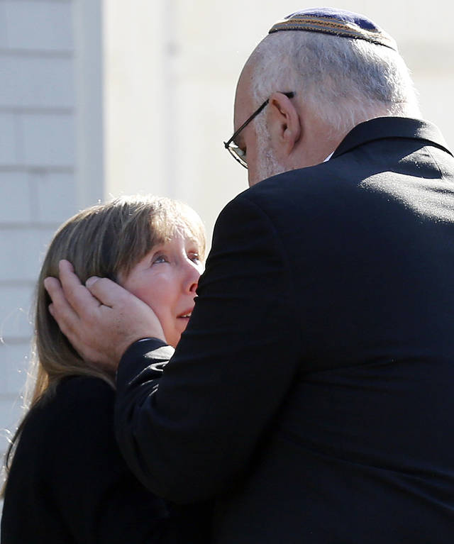 Two people embrace following a service at the Congregation Adath Israel in Newtown, Conn., Saturday, Dec. 15, 2012. Rabbi Shaul Praver said a six-year-old boy from the congregation was a school shooting victim and that he would be buried on Sunday. (AP Photo/Charles Krupa) ORG XMIT: CTCK102